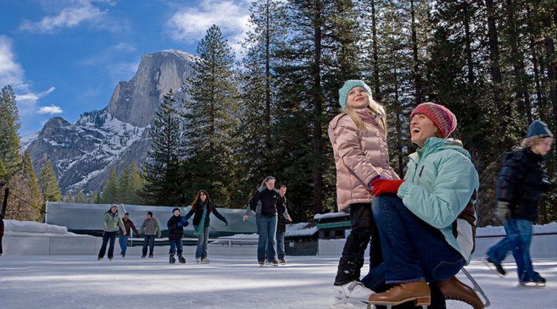 Mom and daughter at the Curry Village ice skating rink at Yosemite
