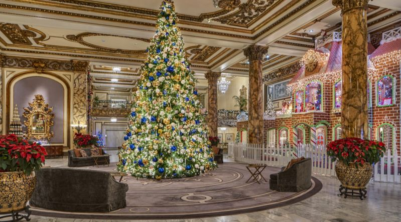 Christmas tree and gingerbread house in lobby at the Fairmont San Francisco