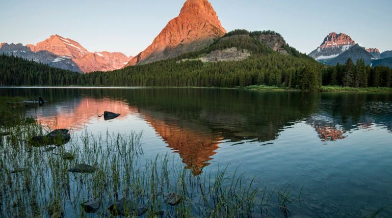 Sunrise view of Swiftcurrent Lake in Glacier National Park on a Highway 89