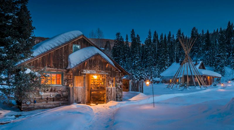 The winter lodges Dunton Hot Springs covered in snow at night