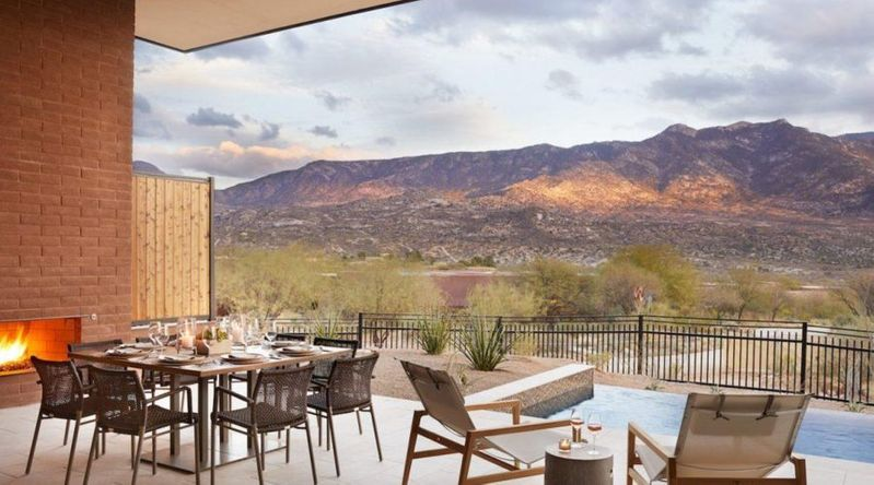 A patio with pool with the mountains in the background at Miraval Tucson, a great hotel for Thanksgiving couples getaways