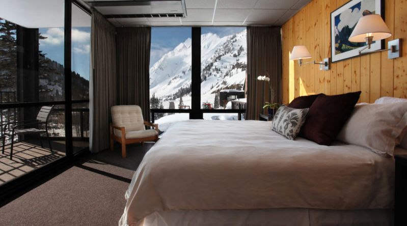 The view of snow-covered mountain from inside a room at Alta Lodge in Utah