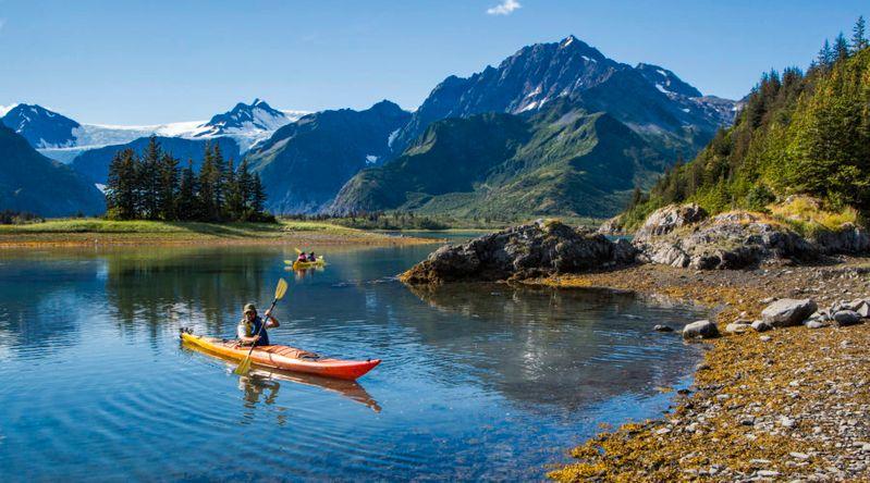Kayakers near mountain shores
