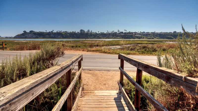 Wooden bridge leading to the water at Back Bay Loop Trail, one of the best hikes in Newport Beach, CA