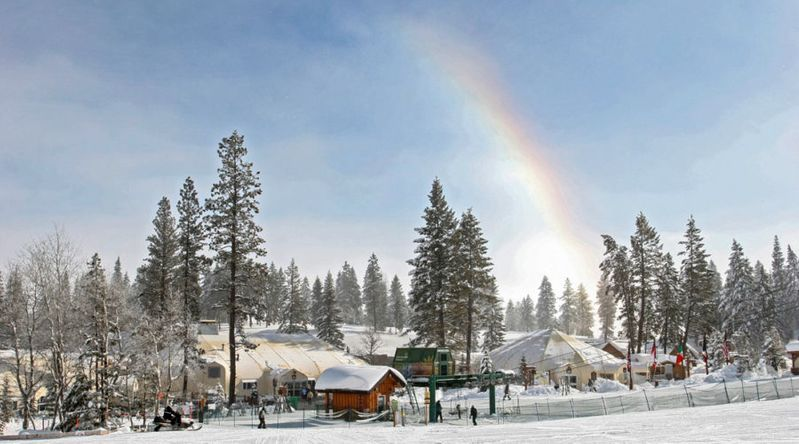 The base at Tamarack Resort with sports and cafe domes and a snow rainbow