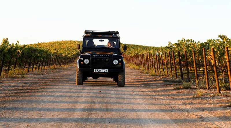 A Land Rover cruises through the vineyards in Napa on a California Wine Country tour