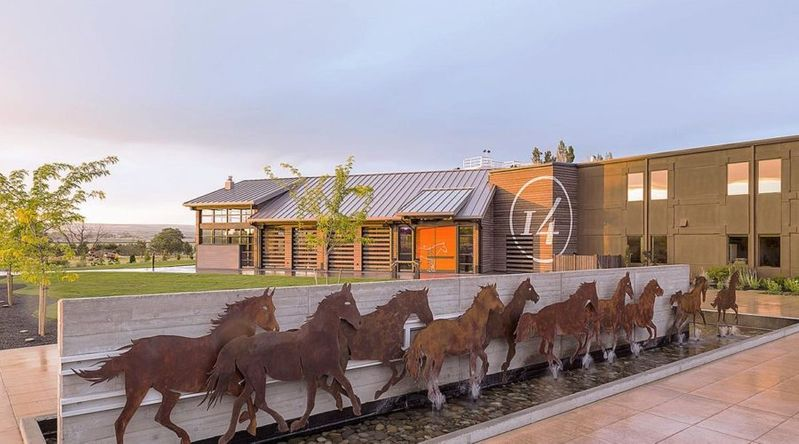 Exterior of 14 Hands Winery at Sunset with horse mural in Prosser's secret wine country