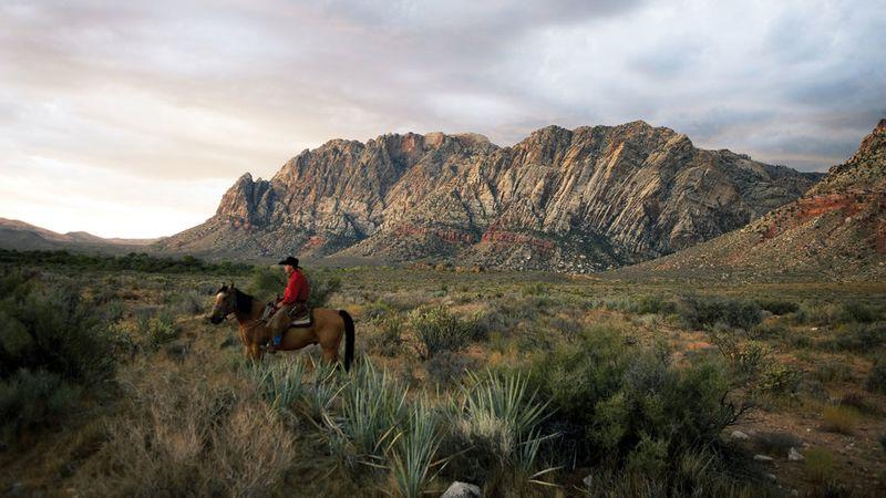 Man horseback riding at Red Rock Canyon National Conservation Area near Las Vegas, NV