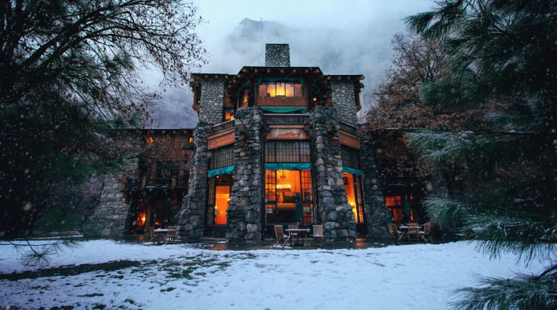 The snow-covered Ahwahnee Hotel, one of the places you must see in Yosemite
