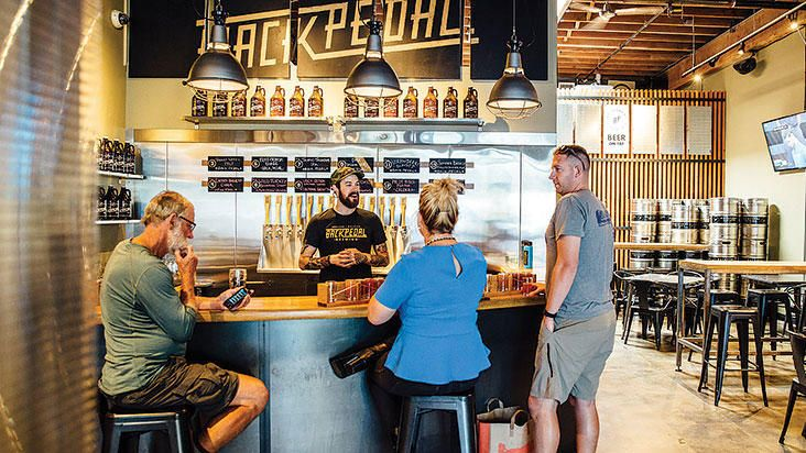 People inside Back Pedal Brewing