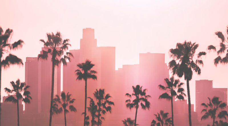 Downtown Los Angeles skyline with pink glow to represent ghost tours in Los Angeles