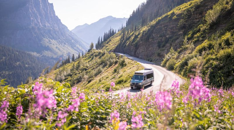 Van riding through the Going to the Sun road in Glacier National Park off Highway 89