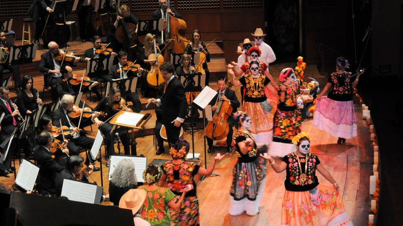 Performers on stage with the Davies Symphony in San Francisco at a Day of the Day Event
