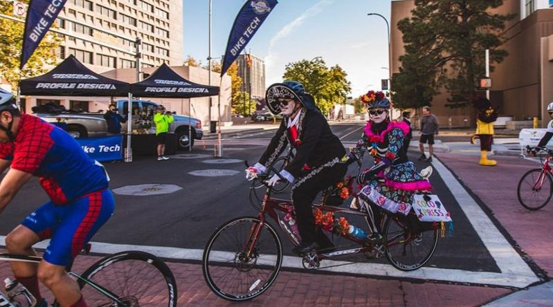 Cyclists in Day of the Dead face paint and costumes and ride tandem bikes on during the Day of the Tread event in Albuquerque