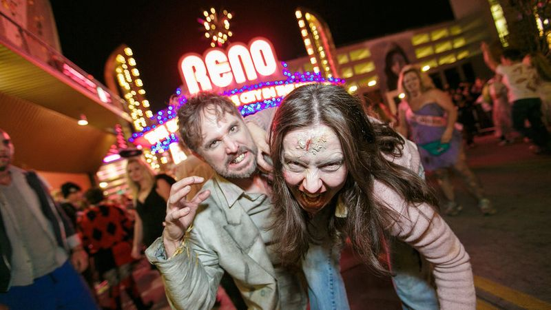 Two people in face paint and costumes at the Halloween event Reno Zombie Crawl