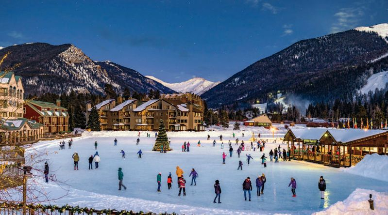The ice skating rink at Keystone with skaters and a Christmas tree