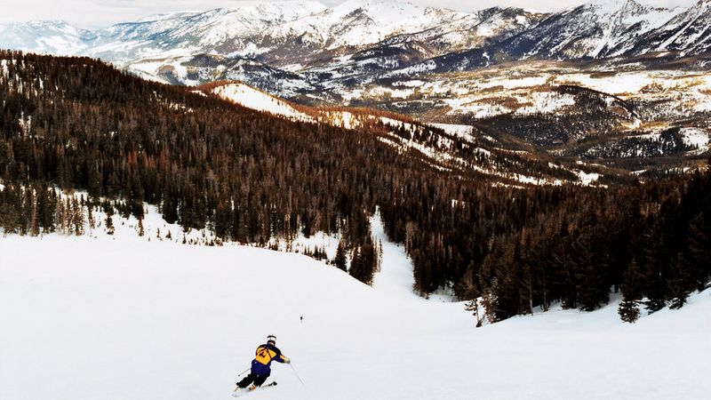 Stillwater Bowl at Moonlight Basin with views of Spanish Peaks and wide-open slopes.