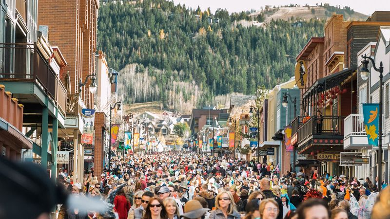 People on the street for the Howl-O-Ween Parade Pet Parade, a Halloween event, in Park City, UT