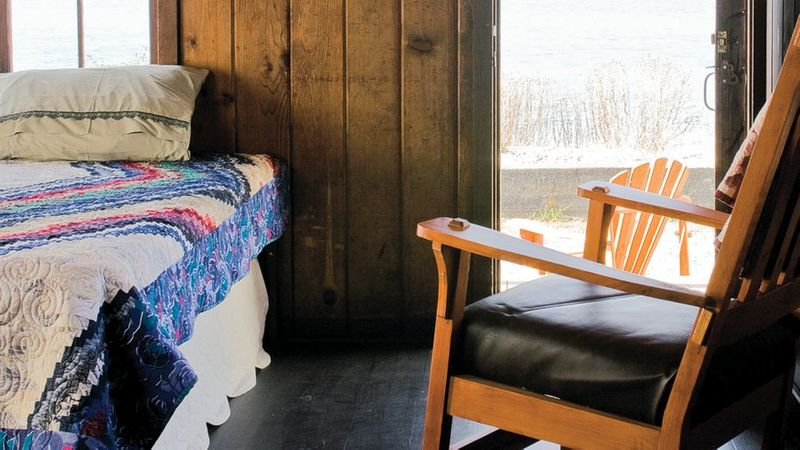 Cozy cabins at Cama Beach State park in Washington inside the room with door open to see view of ocean