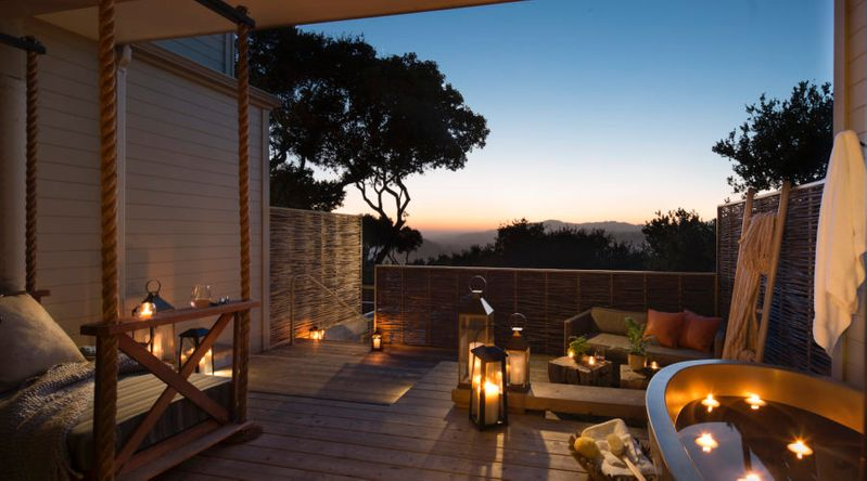 The outdoor tub on the balcony of the Carmel Valley Ranch in California at dusk