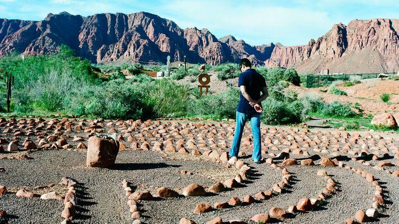 Man walks the Desert Rose Labyrinth in Kayenta, UT