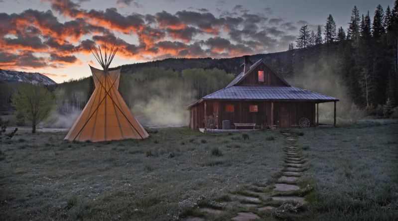 Cozy cabins in front of springs with a teepee at Dunton Hot Springs