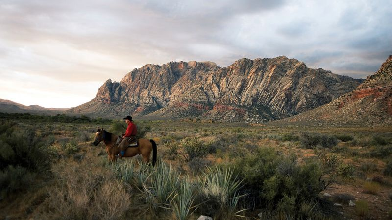 Person horseback riding at Red Rock Canyon National Conservation Area in Vegas