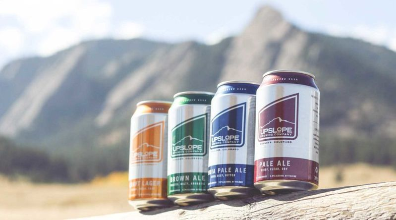 cans of beer in front of mountains, upslope brewing in boulder