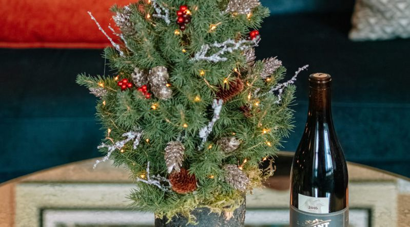 Small spruce tree decorated on a tabletop at the Dossier Hotel in Portland