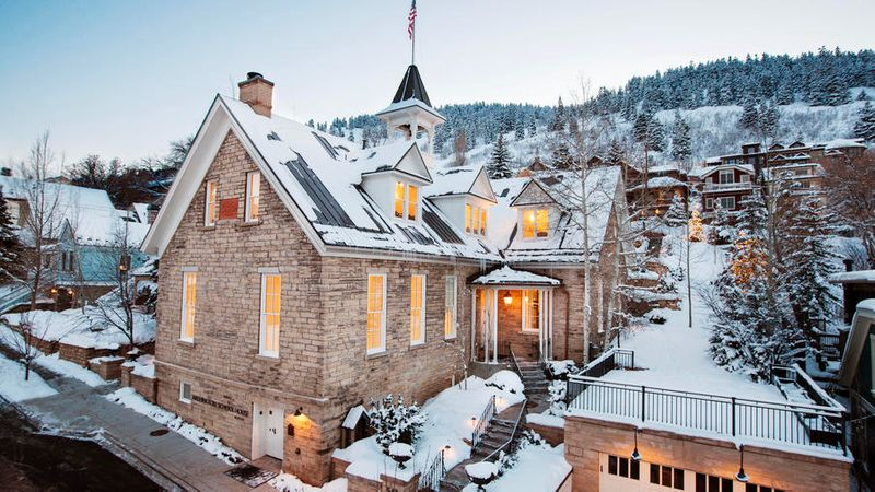 The Washington School House winter lodge in Park City covered in snow